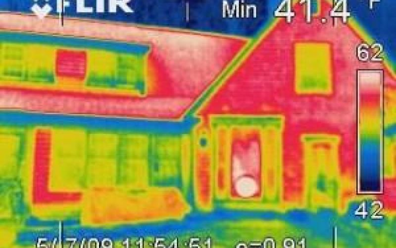 An infrared image of the exterior of a house showing heat loss.