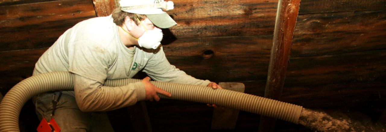 Blowing cellulose insulation in an attic around Augusta, ME by The Breathable Home