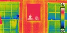 Don't worry, those aren't ghosts. This infrared image catches the reflections off a mirror, as well as the heat transferring through framing studs and windows.